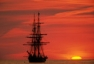 The Niagara tall ship moored at sunset on Lake Erie, off the west shore of Pelee Island, Ontario, Canada.